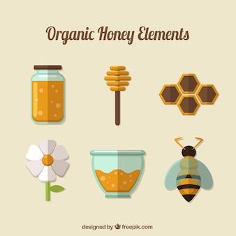Set de elementos de miel ecológica en diseño plano