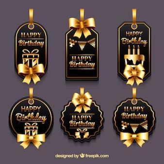 Set de etiquetas lujosas con lazos dorados de cumpleaños