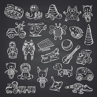 Set de juguetes para niños dibujados a mano y aislados en pizarra negra