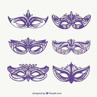 Set de máscaras moradas de carnival dibujadas a mano