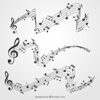 Set de pentagramas y notas musicales