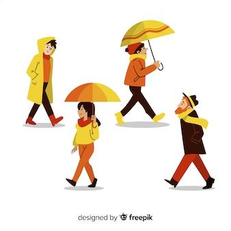 Set de personas paseando en otoño