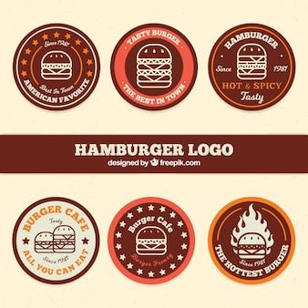 Set de seis logos de hamburguesa redondos en diseño plano