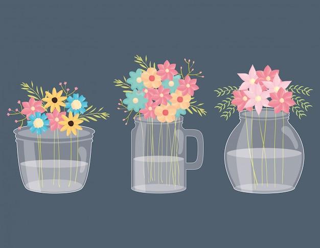 Set de tarros de masón con decoración floral.