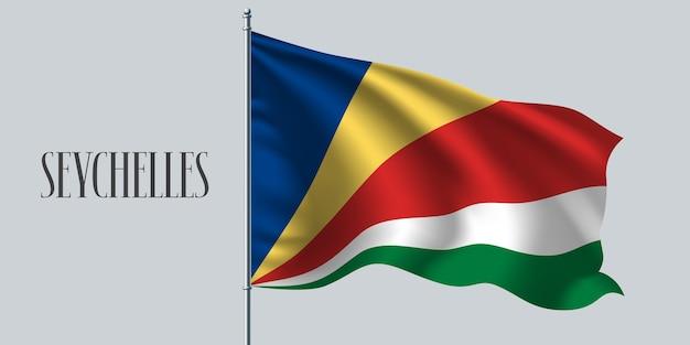 Seychelles ondeando la bandera en el asta de la bandera.