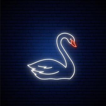 Signo de cisne de neón en la pared azul oscuro