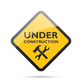 Bajo signo de construcción aislado en blanco