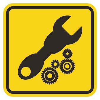 Signo de herramienta de servicio de símbolo sobre fondo amarillo