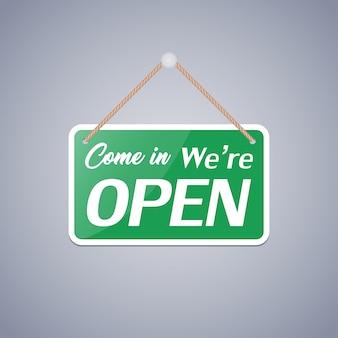 Signo de negocios que dice: ven, estamos abiertos