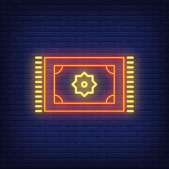 Signo de neón de la alfombra persa. alfombra oriental de mosaico anuncio brillante de la noche.
