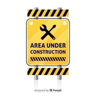 Signo plano amarillo en construcción