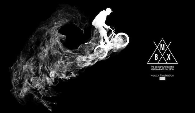 Silueta abstracta de un ciclista de bmx sobre fondo negro