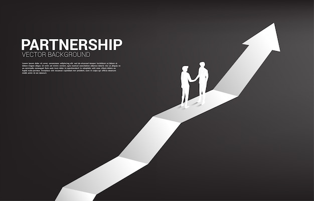 Silueta del apretón de manos del empresario en gráfico creciente. concepto de trabajo en equipo, asociación y cooperación.