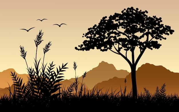 Silueta de árbol y arbusto con montaña