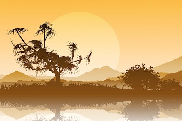 Silueta de árboles contra un cielo de la puesta del sol