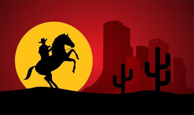 Silueta del caballo de montar a caballo solitario del vaquero en la puesta del sol