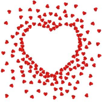 Silueta de corazón forrada con corazones de papel
