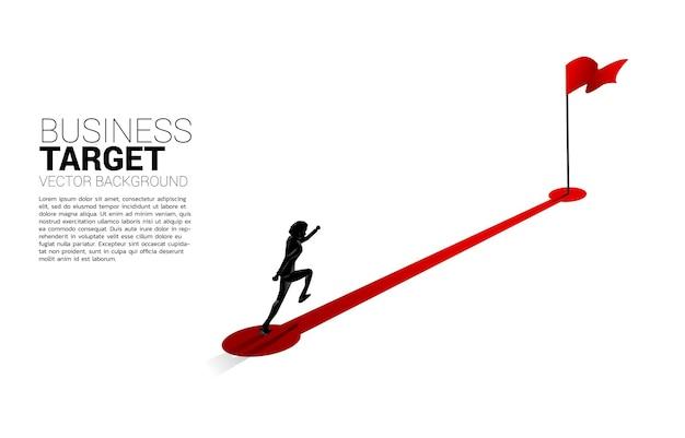 Silueta de empresario corriendo en ruta hacia la bandera roja en la meta.