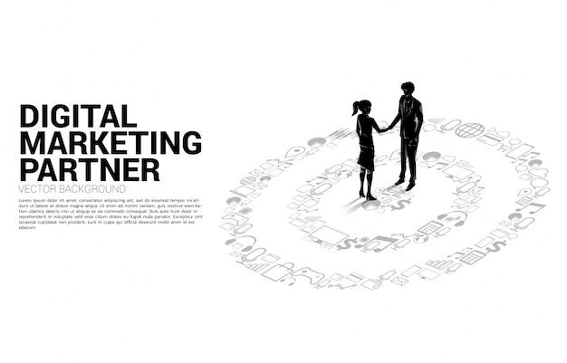 Silueta del empresario y empresaria apretón de manos en el centro del tablero de dardos del icono de marketing. concepto de negocio de objetivo de marketing y cliente