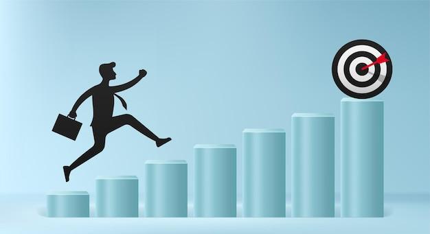 La silueta del empresario salta por encima del obstáculo para tratar, superar el negocio y el concepto de éxito