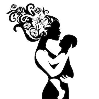 Silueta de hermosa madre con su bebé