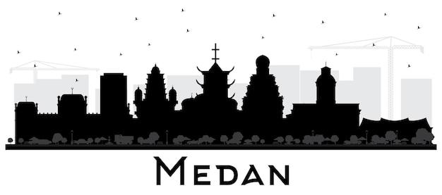 Silueta del horizonte de la ciudad de medan indonesia con edificios negros aislados en blanco. ilustración de vector. concepto de turismo y viajes de negocios con arquitectura histórica. paisaje urbano de medan con hitos.