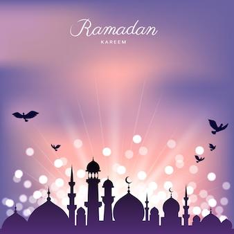 Silueta de la mezquita y luz abstracta para el ramadán del islam