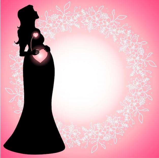 Silueta de mujer embarazada con corazones conectados que brillan intensamente