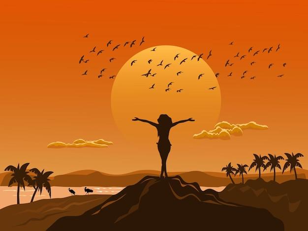 La silueta de la mujer se puso de pie y mostró sus manos en la cima de la montaña con alegría. hay mar, montañas, pájaros y fondo de puesta de sol.