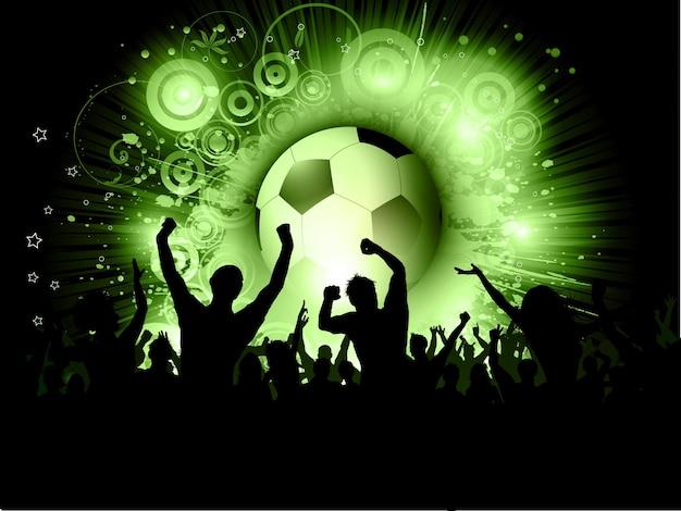 Silueta de una multitud emocionada contra una pelota de fútbol