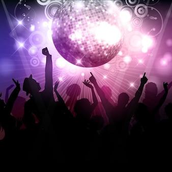 Silueta de multitud de gente en una discoteca