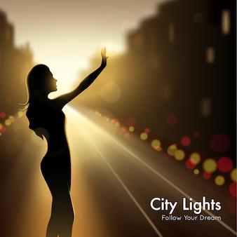 Silueta de niña en luces de la ciudad