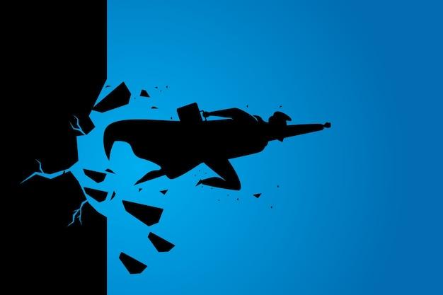 Silueta superbusinessman rompiendo la pared