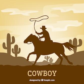 Silueta de vaquero montando caballo