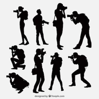 Siluetas de fotógrafos con cámara