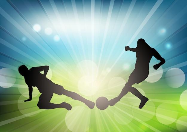 Siluetas de jugador de fútbol sobre un fondo desenfocado