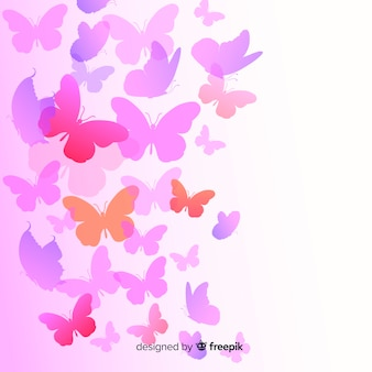 Siluetas de mariposas volando en degradado