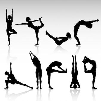 Siluetas de las mujeres en varias poses de yoga