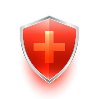 Símbolo de protección de escudo médico aislado con cruz