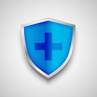 Símbolo de protección de escudo médico con signo de cruz