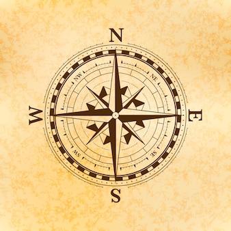 Símbolo de rosa de los vientos vintage, antiguo icono de brújula en papel amarillo antiguo