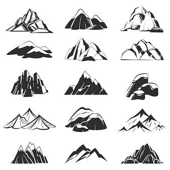 Símbolos de montaña. montañas de silueta con nieve de rango