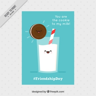 Simpática tarjeta de la amistad con una galleta y leche
