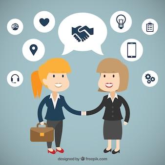 Simpáticas mujeres de negocios estrechando la mano