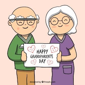 Simpático dibujo de abuelitos con un cartel