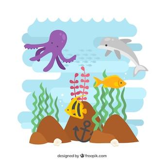 Simpáticos animales bajo el mar con algas