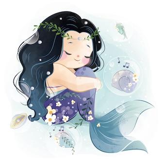 Sirena encantadora sentada doblando su aleta