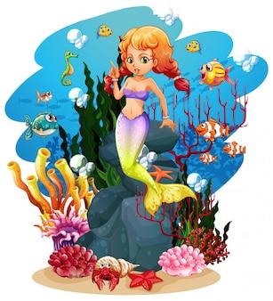 Sirena y muchos peces en el océano.