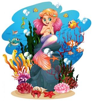 Sirena y peces bajo el agua