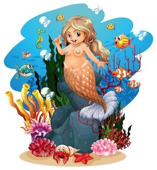Sirena y pez bajo el mar